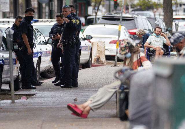 HPD Police officers gather along River Street to cite homeless inviduals during COVID-19 pandemic. October 23, 2020