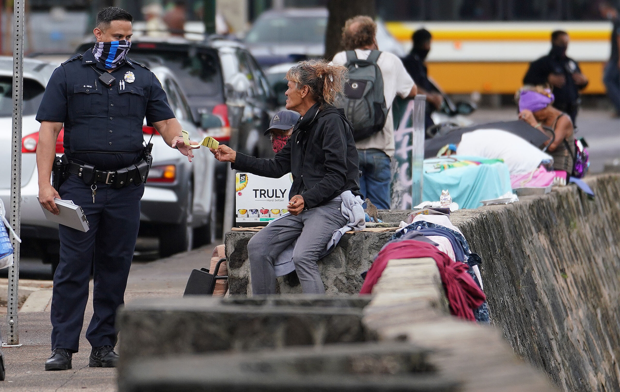 <p>Yvonne Christie, 63, was cited on Oct. 23 for sitting on the River Street wall with a shopping cart of belongings. Christie says she is trying to get help to get into housing, but in the meantime, she is waiting for her COVID-19 test results to gain access to sleep in a nearby shelter.</p>