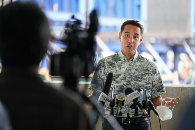 Honolulu City council member Joey Manahan speaks at Mayor Caldwell's rail plan press conference held at the Daniel K. Inouye International Airport parking garage.