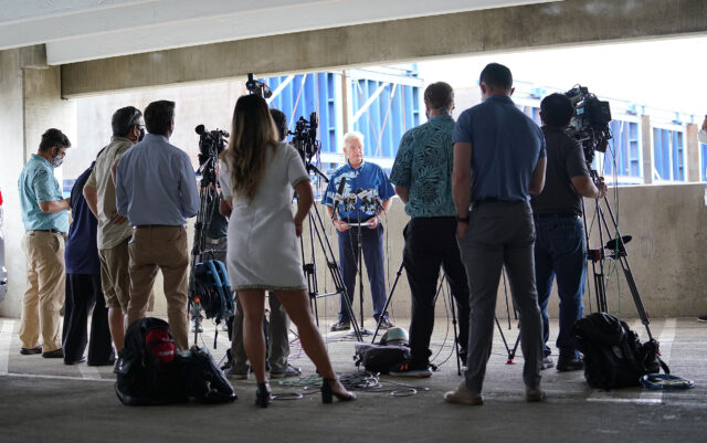 Media crowded together during Mayor Kirk Caldwell's 'conceptual rail plan' press conference held at the Daniel K. Inouye International Airport parking garage.