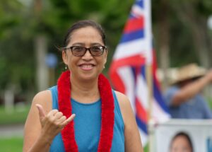 Honolulu City Council District 3 candidate, Esther Kia'aina flashes a shaka while sign waving on the Windward side of Oahu, Tuesday, October 27, 2020. (Ronen Zilberman photo Civil Beat)