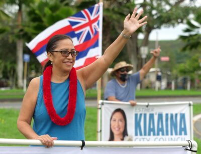 Honolulu City Council District 3 candidate, Esther Kia'aina waves to drivers on the Windward side of Oahu, Tuesday, October 27, 2020. (Ronen Zilberman photo Civil Beat)