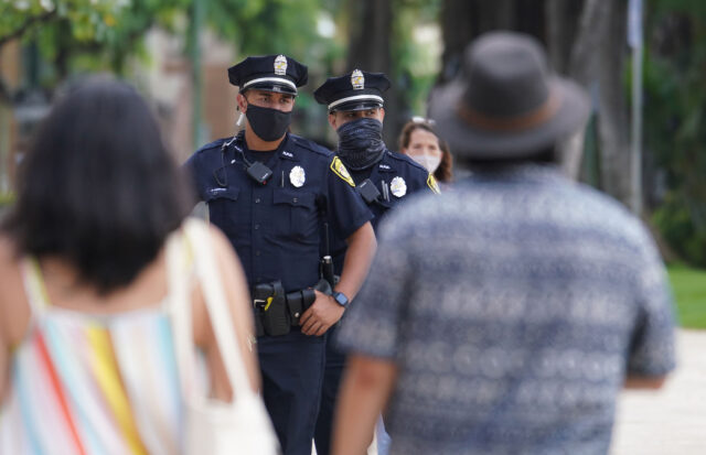 HPD Honolulu Police officers patrol along Kalakaua Avenue during COVID-19 pandemic. October 28, 2020