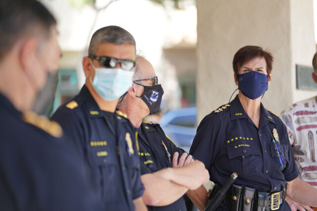 HPD Honolulu Police Chief Susan Ballard stands with colleagues before press conference at the Waikiki substation during COVID-19 pandemic.