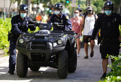 HPD Honolulu Police officers move ATV Quad / 4 wheeler outside the Waikiki substation.