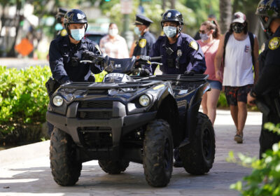 HPD Honolulu Police officers move an ATV Quad/ 4 wheeler outside the Waikiki Substation.