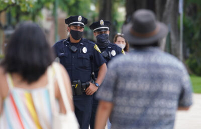 HPD Honolulu Police officers patrol along Kalakaua Avenue during COVID-19 pandemic. October 28, 2020