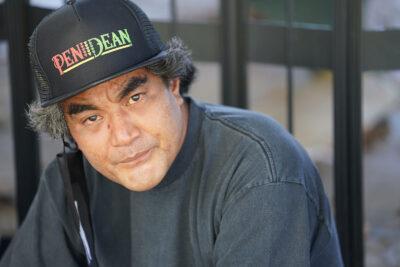 Jay Sohl sits in the shade along Kalakaua Avenue.