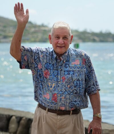 Sam Slom, candidate for State Senate district 9 waves in Hawaii Kai, Saturday October 31, 2020. (Photo: Ronen Zilberman/Civil Beat)