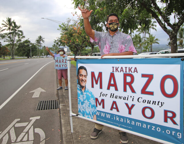 Ikaika Marzo, candidate for Big Island Mayor, sign-waves with supporters along Hilo Bayfront. Photo: Tim Wright