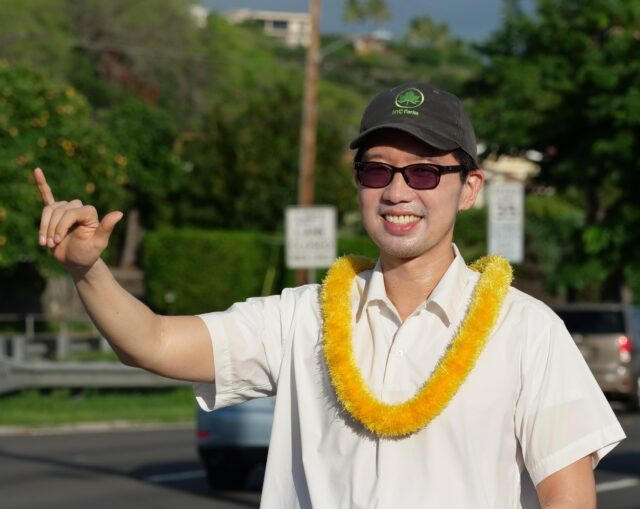 Stanley Chang, candidate for State Senate district 9 waves to cars on the eve of election day Monday, November 2, 2020. (Ronen Zilberman photo Civil Beat)