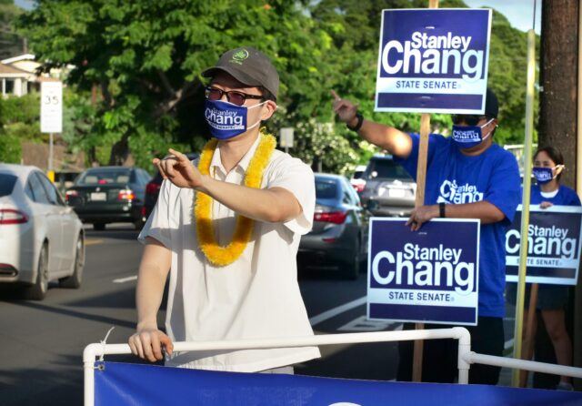 Stanley Chang, candidate for State Senate district 9 waves to cars with some of his supporters on the eve of election day Monday, November 2, 2020. (Ronen Zilberman photo Civil Beat)