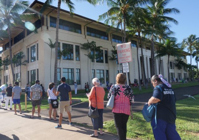 Voters wait in a long line stretching down the street to cast their ballots at the Kapolei City Hall on election day Tuesday, November 3, 2020. (Ronen Zilberman photo Civil Beat)