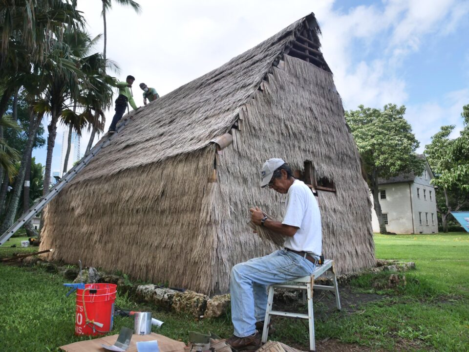 Dwight Kauahikaua, seated, Kaspar Carewell, top left, and Earl Kawaa build a hale at the Hawaiian Mission House historic site, in Honolulu, HI, Tuesday, November 3, 2020. (Ronen Zilberman photo Civil Beat)