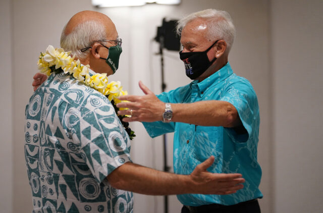 Mayor Kirk Caldwell gives a lei to Mayoral candidate Rick Blangiardi at the Alohilani Hotel.