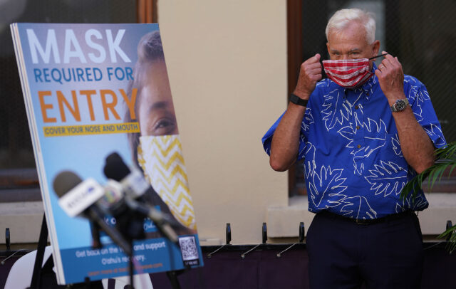 Mayor Kirk Caldwell masks up at press conference announcing the www.Backonthewave.com site and reopening bars safely during COVID-19 pandemic. Caldwell announced 125 positve COVID-19 cases today and urged the public to be vigilant. November 4, 2020