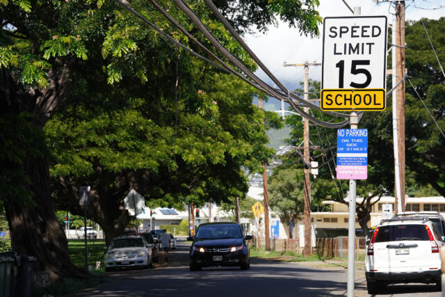 Signs along Leahi Street saying 'no parking on this side of street' on private road.