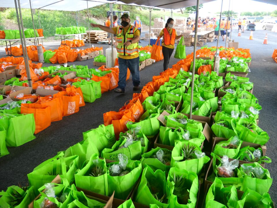 Volunteers organize bags of food to be given out during a Foodbank pop-up drive-thru food distribution event at the Waiane Mall Saturday, November 7, 2020. (Ronen Zilberman photo Civil Beat)