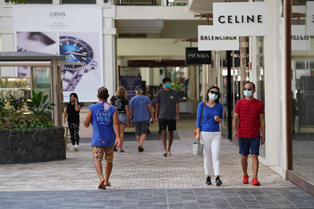 Shoppers do their best to social distance and wear their masks at Ala Moana Center during COVID-19 pandemic.