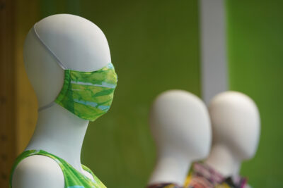 Mannequins in the window of Jams World sports a mask at Ala Moana Center during COVID-19 pandemic.
