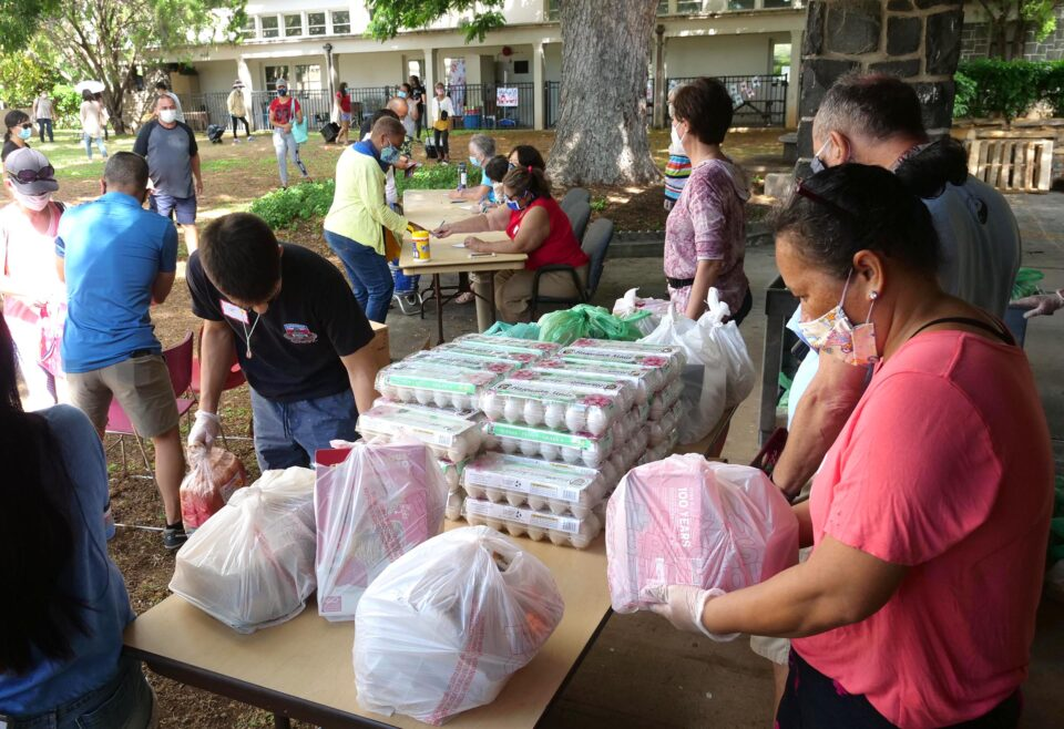 Volunteers bag food donations as people sign-up to receive the packages of food during a distribution event hosted by the Central Union Church in Honolulu, on Wednesday, November 11, 2020. (Ronen Zilberman photo Civil Beat)