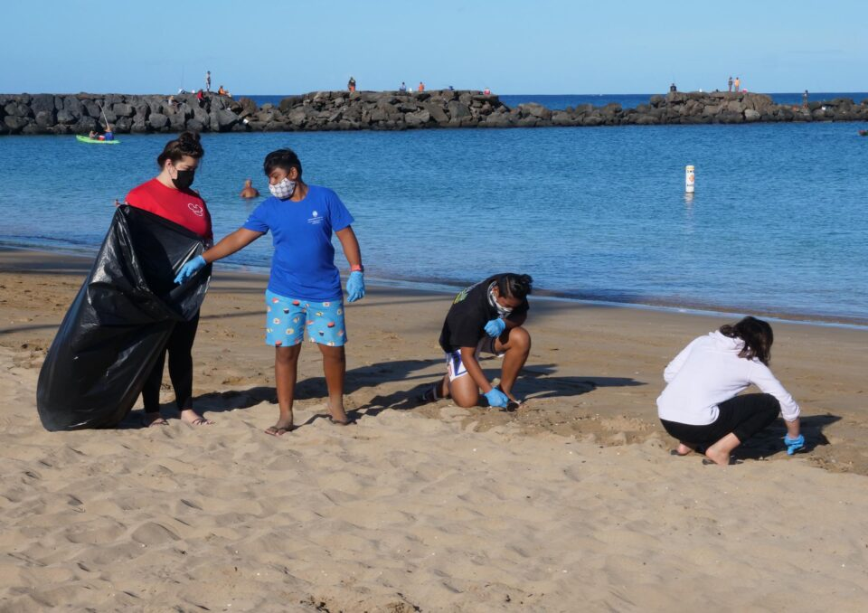 Volunteers pick-up trash from the beach at Pokai Bay as part of a community effort to cleanup and care for the park grounds and facilities on Saturday, November 14, 2020.  Because the area has not been well maintained by the City & Conty community members decided to come together to address the issues.  (Ronen Zilberman photo Civil Beat)