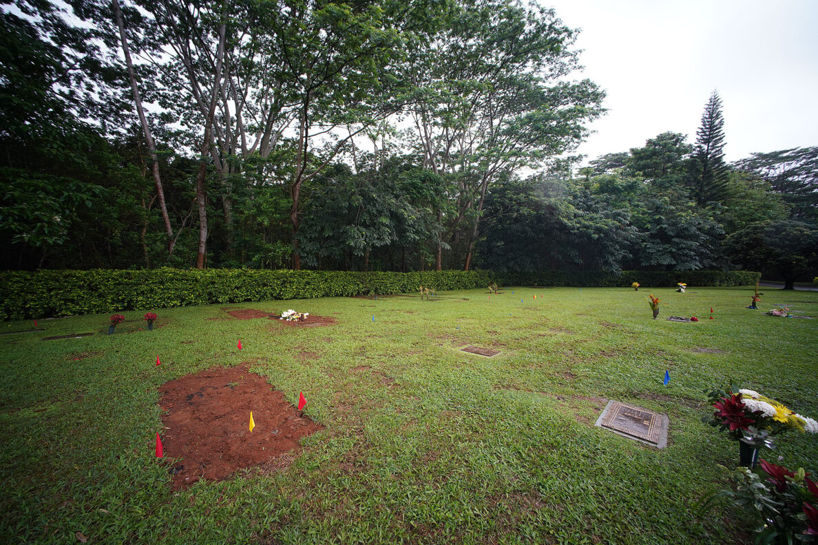 Fresh earth covers the grave of Neither Bolkeim at Hawaiian Memorial Park located in Kaneohe.
