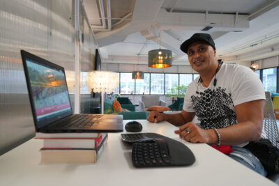 Kanu Hawaii Executive Director Keone Kealoha sits inside the Hub Coworking Hawaii space located in Kakaako.