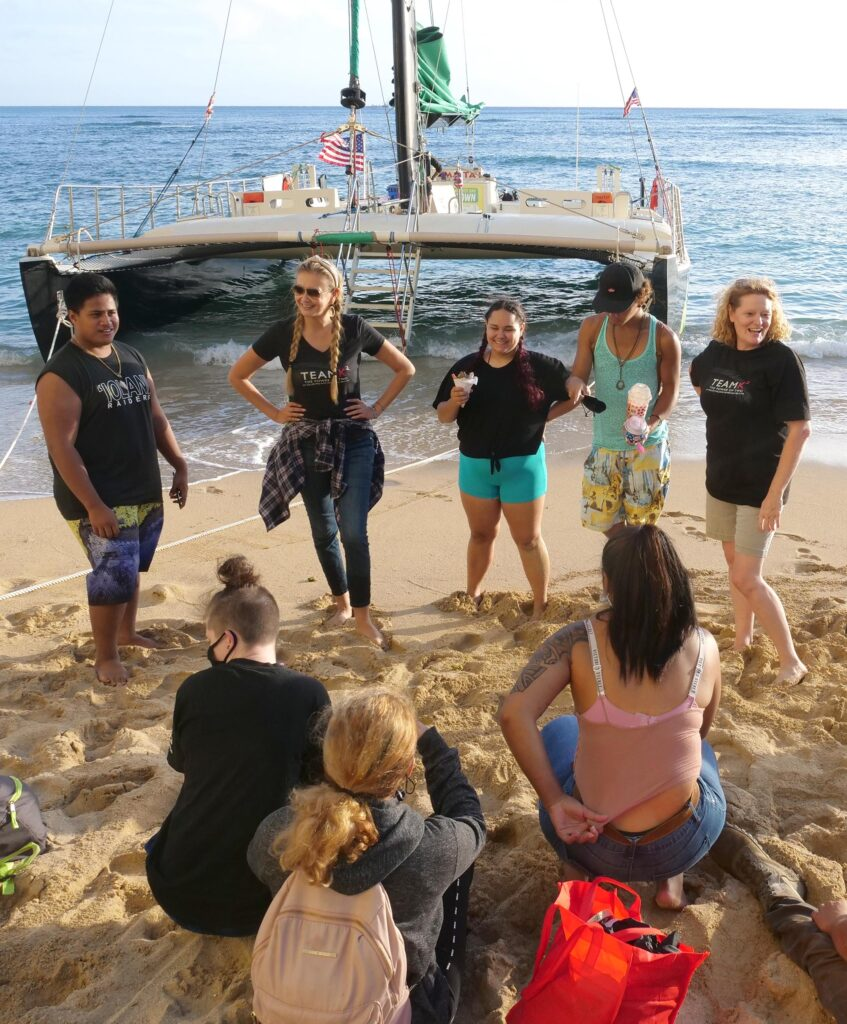 Kina Knisley (far right), a Team K2 Realtor, volunteered to sponsor a catamaran cruise for youth from RYSE on Monday, November 23, 2020. RYSE is a shelter that empower's Hawaii's street youth to move beyond homelessness helping them earn high school diplomas and learn job skills. (Ronen Zilberman photo Civil Beat)