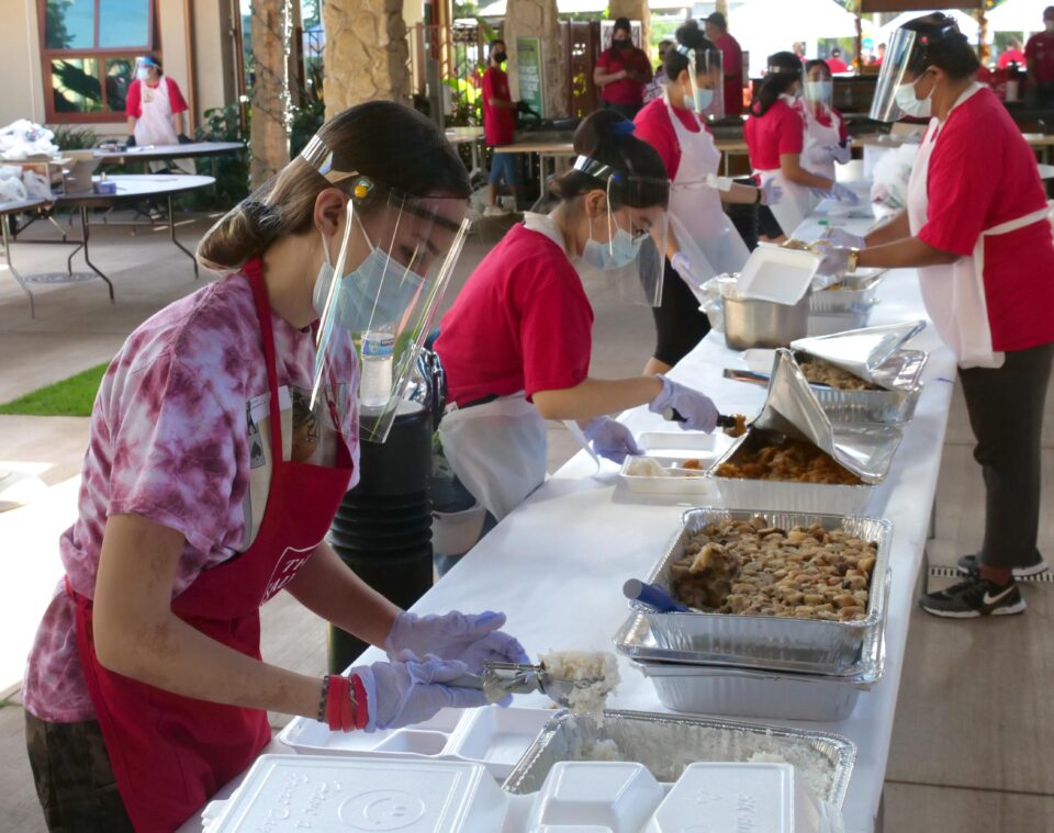 Volunteers with The Salvation Army Kroc Center Hawaii prepare meals for giving out during their Thanksgiving 'Ohana Drive-Thru Event Thursday, November 26, 2020. The event distributed 2,100 meals and treated everyone to entertainment and blessing stations. (Ronen Zilberman photo Civil Beat)