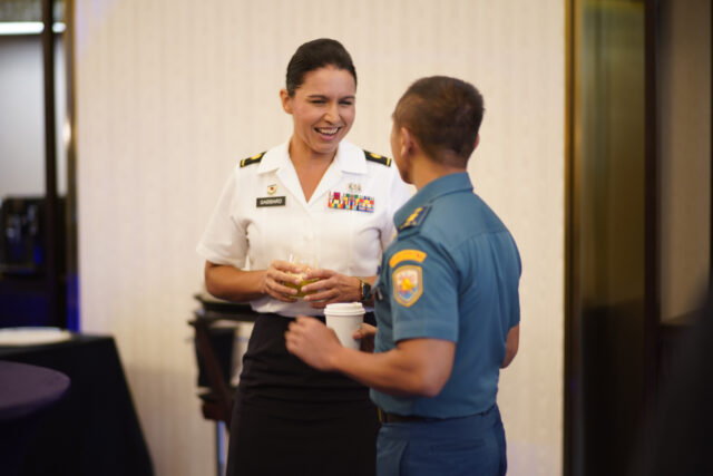 Maj. Tulsi Gabbard, Hawaii Army National Guard military police officer, reviews the operation design process with a Tentara NasionalIndonesia officer during a group break out, Jakarta, Indonesia, August 19, 2019. Hawaii National Guard is State Partners with Indonesia and regularly holds combined exercises and events to increase the depth of that relationship. This is the second year the Hawaii and Indonesia have participated in an operation design seminar. operation design is a process where a committee of military members and sometimes members of government examine very complex problems to help define variables, goals, tension points and desired end state to aid in the planing and execution of military or governmental action. (U.S. Air National Guard Photo by Tech. Sgt. Andrew Jackson)