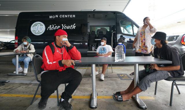 Left, Farrington High School Senior, Nethaniah Tuua talks to his Adult Friends for Youth colleagues.