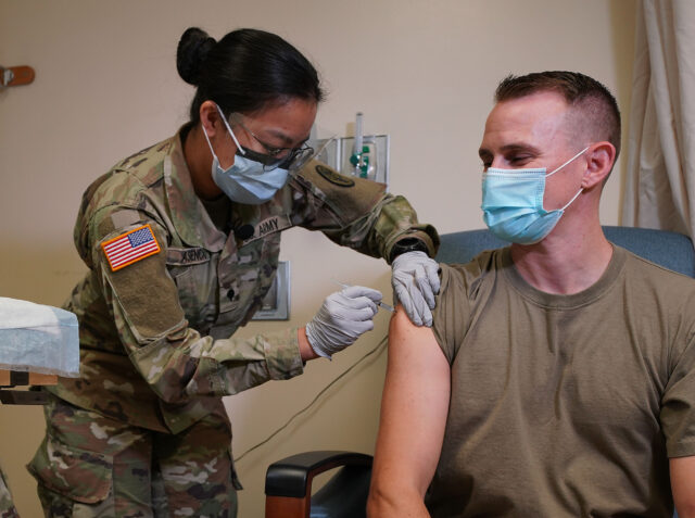 Army Medic Angela Asencio gives Army Captain Jason Tuttle part #1 of Pfizer-BioNTech COVID-19 vaccine at Tripler Army Medical Center. December 17, 2020