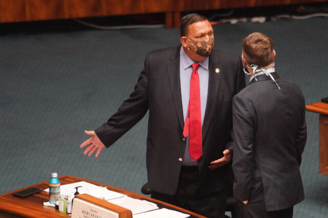Senator Kurt Fevella speaks with Senator Gil Riviere before floor session begins at the Capitol during COVID-19 pandemic. July 6, 2020