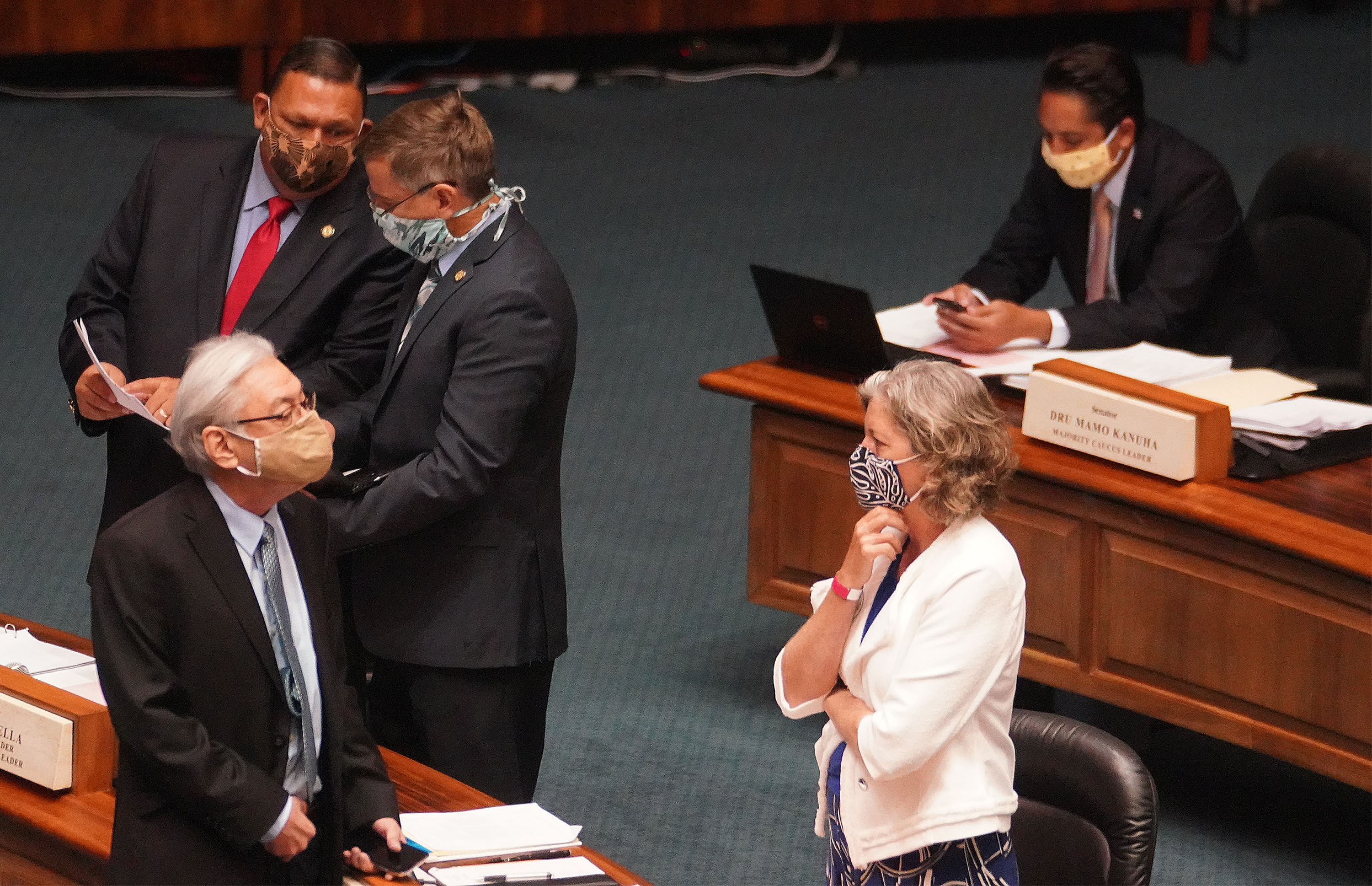 <p>The Legislature managed to still hold floor sessions during the COVID-19 pandemic. In the foreground, Sen. Laura Thielen shares a conversation with Sen. Les Ihara. In the background, Sen. Kurt Fevella, left, chats with Sen. Gil Riviere in July.</p>