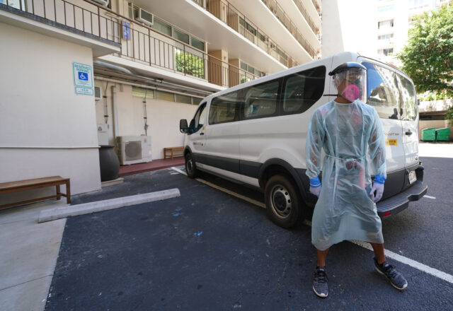 Patient transporter Randy Puootuuo stands in full personal protective equipment outside the van he drives during media tour at the Pearl Hotel Waikiki. September 10, 2020
