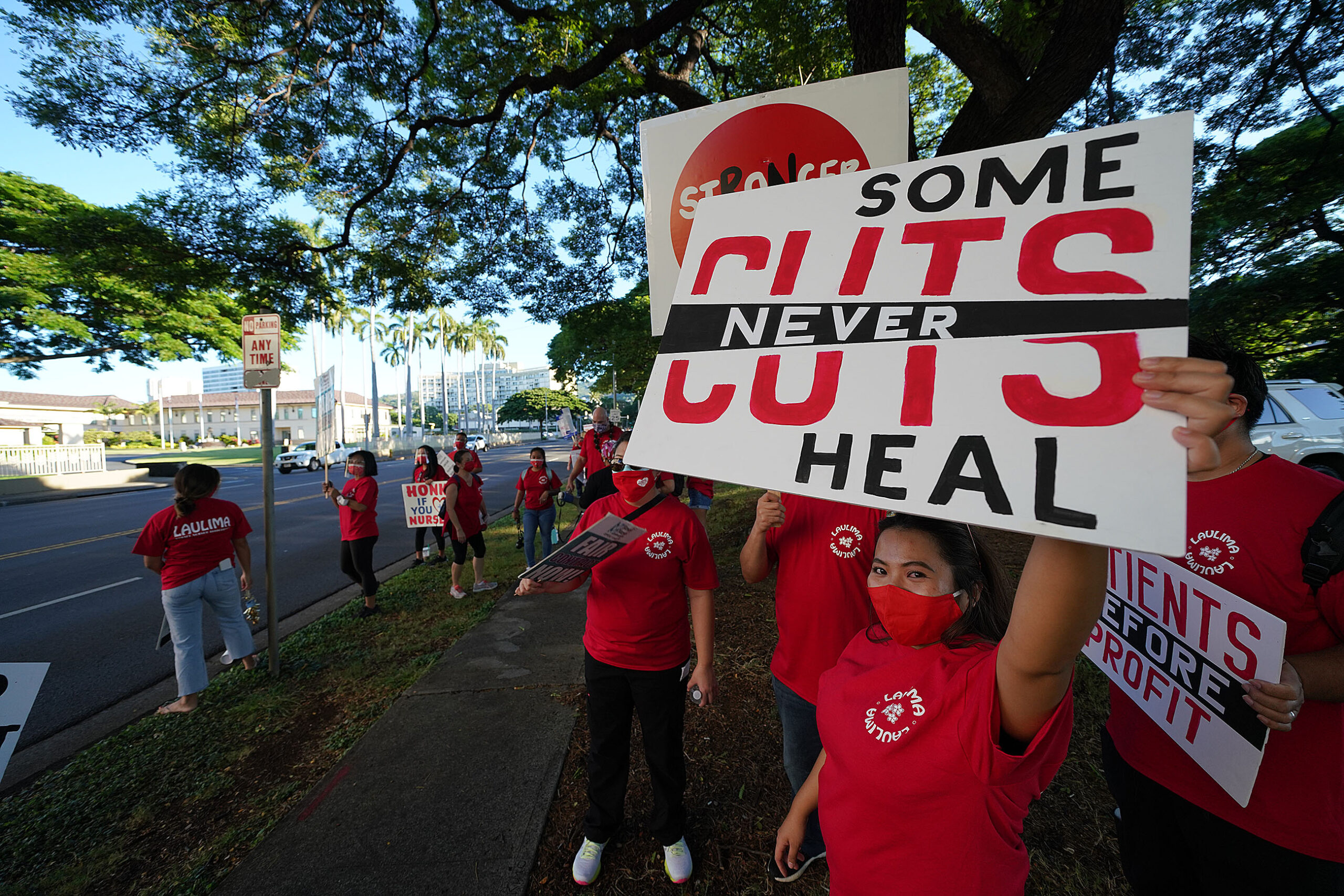 <p>Nurses protested on Punahou Street near Kapiolani Women's and Children's Hospital during the COVID-19 pandemic in December. They were demanding better coronavirus protections as part of negotiating a new three-year contract.</p>