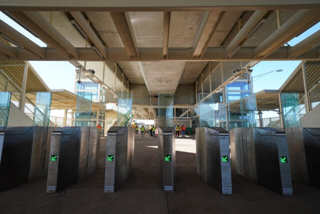 Aloha Stadium rail station with Holo readers and entrance to the station.