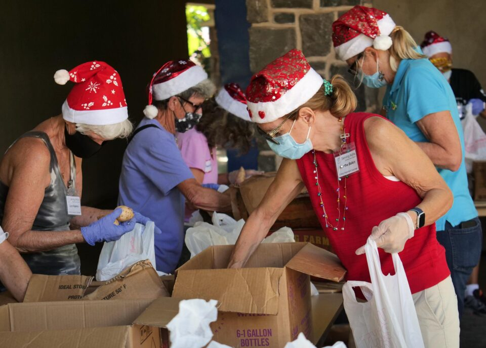 Volunteers dressed in the spirit of Christmas prepare for a food drive at the Central Union Church in Honolulu. Wednesday, December 23, 2020 (Photo: Ronen Zilberman/Civil Beat).