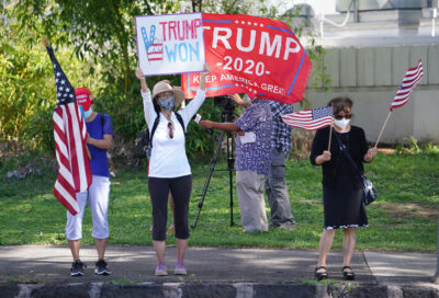 Trump supporters holds signs and flags along King Street, fronting the Capitol. January 6, 2021.