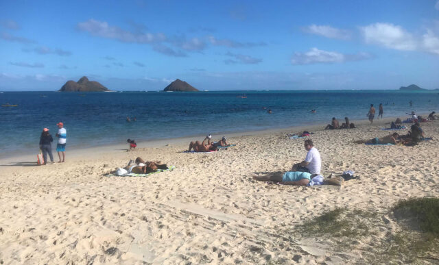 Visitors socially distance themselves at Lanikai Beach during the COVID-19 pandemic. January 7, 2021