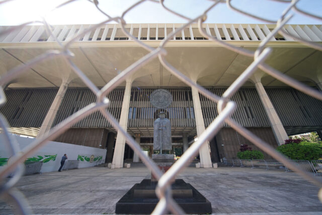 Father Damien statue as seen thru the newly installed fenced barrier at the Capitol. January 13, 2021.