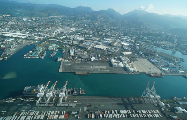 Honolulu Harbor on the left, Wharf 38, below the photo, Matson container shipping company crane. January 2021.
