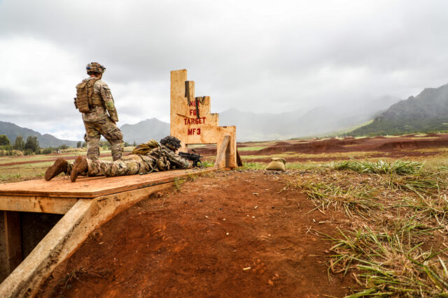 A Soldier from 1st Battalion, 27th Infantry Regiment, 2nd Infantry Brigade Combat Team, 25th Infantry Division, prepares to fire his M249 from the prone position at a pop-up range on Schofield Barracks, August 7, 2020. The Soldiers went to the range to qualify on their squad automatic weapons.(U.S. Army photo by Sgt. Ryan Jenkins)