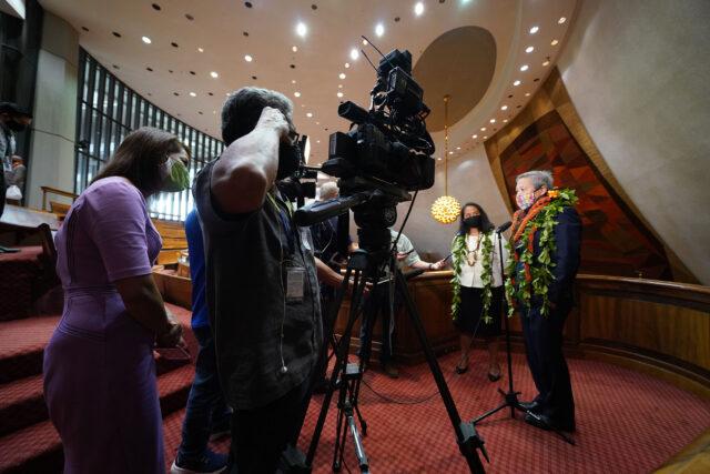 Representative Della Au Belatti and House Speaker Scott Saiki speak to media after opening day at the legislature.
