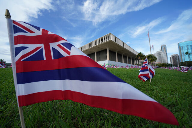 Hawaiian flags on the lawn on opening day of the Legislature at the Capitol.
