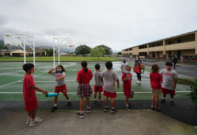 St. Ann School third and fourth graders line up to head back into their classroom after recess.