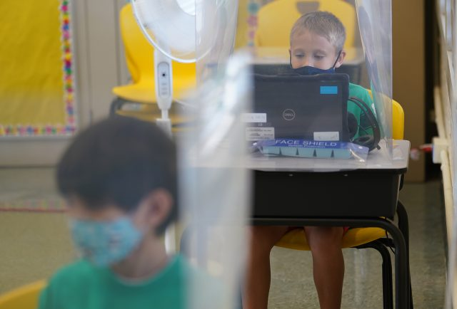 Ala Wai Elementary school students study behind plastic barriers on their desks during COVID-19 pandemic. February 11, 2021