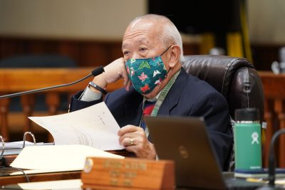 Honolulu City Council member Calvin Say sits masked during city council meeting held at Honolulu Hale.
