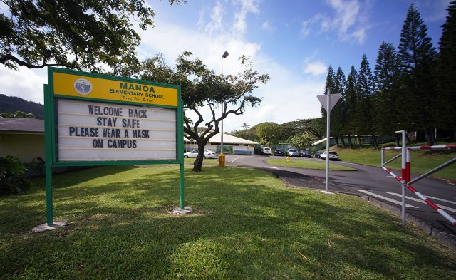 Manoa Elementary School sign welcomes back students to in person classes during COVID-19 pandemic.